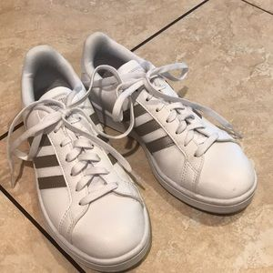 Leather adidas athletic shoes.